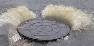 Manhole flooding blocked drain Cambridge